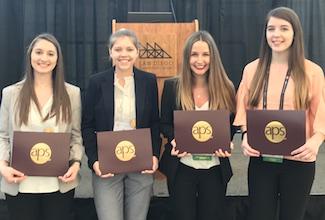 Four undergrads holding awards