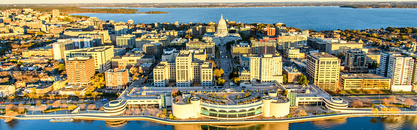 Lake Mendota and Lake Monona, along with the downtown Madison Isthmus and Wisconsin State Capitol, are pictured in an early morning aerial taken from a helicopter on Oct. 23, 2018. (Photo by Bryce Richter /UW-Madison)
