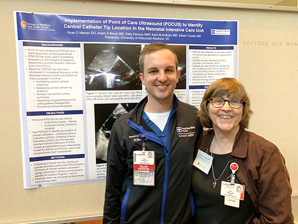 Neonatology and Newborn Nursery fellow Ryan Meinen, DO, is joined by Neonatology and Newborn Nursery faculty member Pamela Kling, MD, by his poster on the use of point-of-care ultrasound in the neonatal intensive care unit.