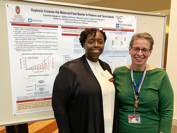 Neonatology and Newborn Nursery fellow Claudette Adegboro, MD, shares her poster on how oxytocin crosses the maternal-fetal barrier in preterm and term infants with Neonatology and Newborn Nursery distinguished scientist Christine Sorenson, PhD.