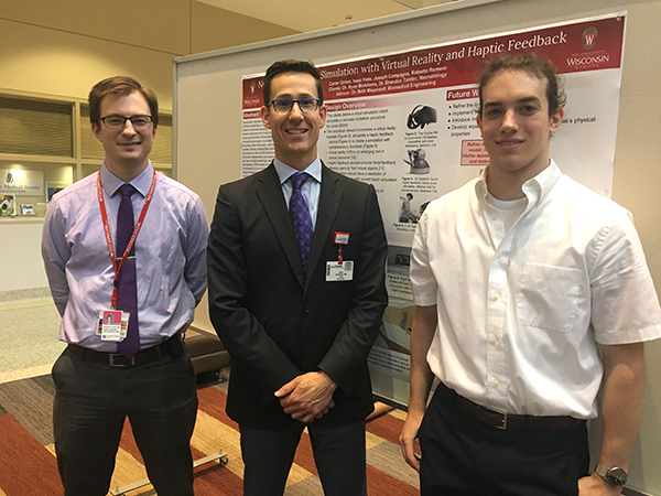 Resident Brandon Tomlin, MD, and Ryan McAdams, MD, with UW Department of Biomedical Engineering undergraduate student Joseph Campagna