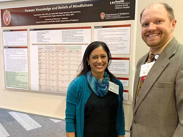 General Pediatrics and Adolescent Medicine faculty member Mala Mathur, MD, MPH, shares her poster on parental understanding of mindfulness with Allergy, Immunology and Rheumatology faculty member Eric Schauberger, DO, PhD.