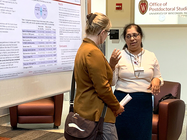 General Pediatrics and Adolescent Medicine Division Chief Megan Moreno, MD, MSEd, MPH, talks with Endocrinology postdoctoral fellow Yashoda Naik, MD, during the Research Day poster session.
