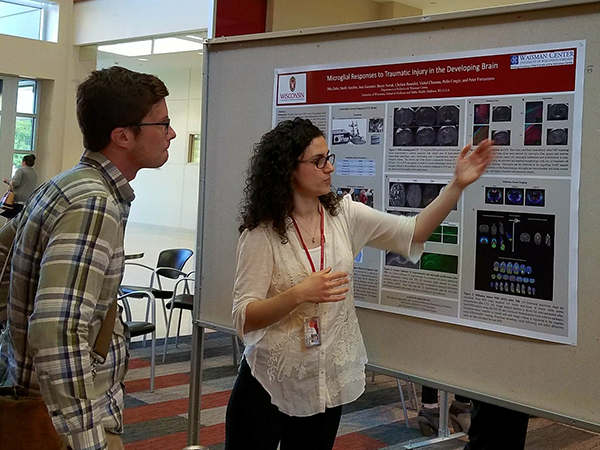 Dila Zafer, a research associate in the laboratory of Pelin Cengiz, MD, discusses her poster