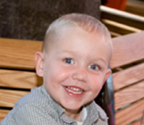 Tyler is now happy and healthy after receiving live-saving treatment for a rare enzyme deficiency.