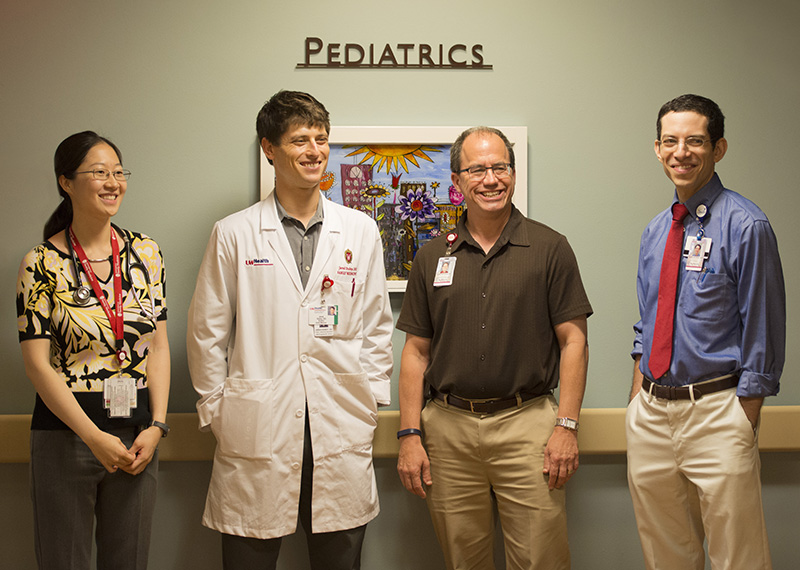 From left: UW family medicine residents Lydia Chen, MD, and Jared Dubey, DO, with Jonathan Fliegel, MD, and Daniel Sklansky, MD, at the St. Mary's inpatient pediatrics unit.