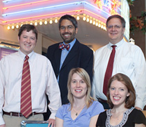 In 2009, four of our physicians-in-training received national recognition for their scholarly work. Standing, from left: Allergy & Immunology fellow Dan Jackson, MD; resident Dipesh Navsaria, MD, MPH, and Vice Chair for Education John Frohna, MD, MPH. Seated, from left: Endocrinology & Diabetes fellow Lindsey Nicol, MD, and resident Katherine Baker, MD.