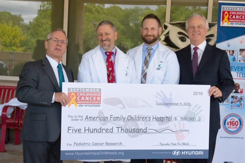 Drs. Otto and Pytel presented with check