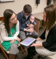care provider, parents and young child discussing genetic screening