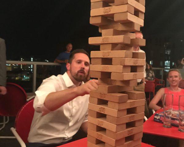 a person playing Jenga