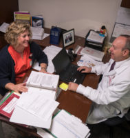 two people sitting at a desk