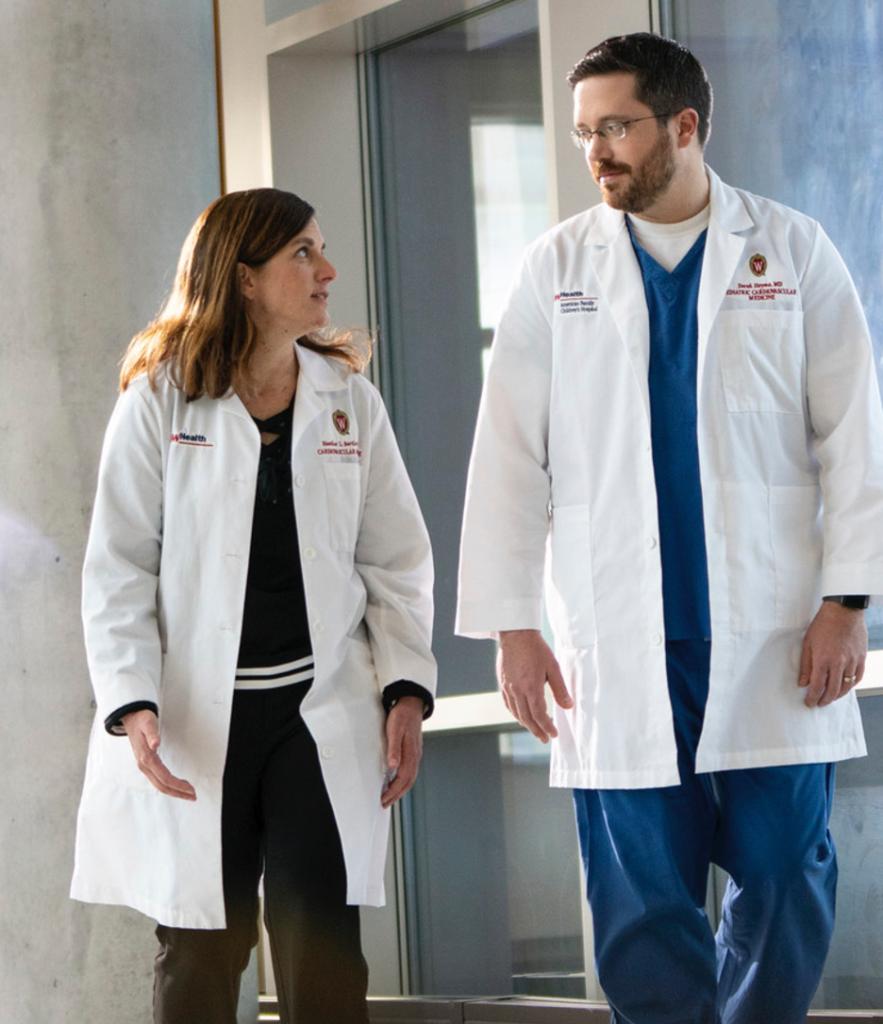 Two doctors walking side by side